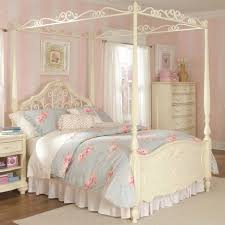 white stained wooden bed with white canopy and curtain combination