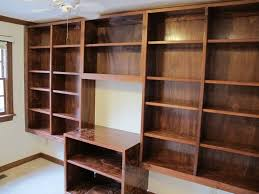 endearing brown wooden laminate bookshelves above flooring and