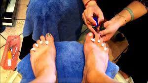 man getting toes polished u0026 painted at nail salon youtube