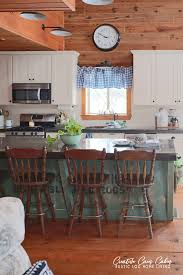 blue kitchen cabinets in cabin log cabin kitchen with blue and green decor creative cain