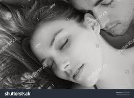 royalty free black and white portrait of young 258277796 stock black and white portrait of young attractive romantic couple hugging and kissing laying down on a bed having sex and being loving with each other