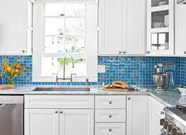 blue glass tile kitchen backsplash blue glass tile kitchen backsplash with black countertops and a