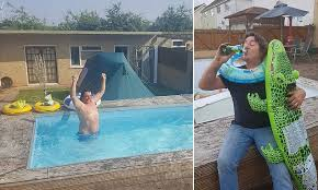 dad builds a swimming pool in garden to cover up giant hole he dug