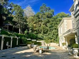 enjoying the serene and beautiful backyard and gardens at the
