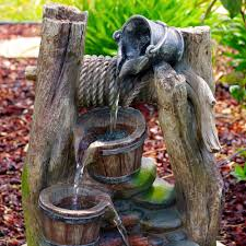 sunnydaze outdoor wishing well with cascading buckets water
