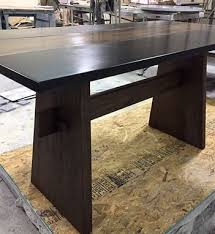 handmade live edge dining table with concrete by 910 castings