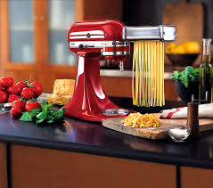 kitchen red kitchenaid pasta cutter on black marble countertop