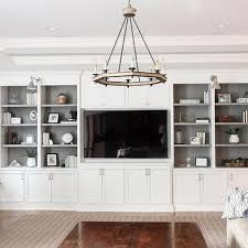 livingroom cabinets living room with white built in shelving and grey backs park and