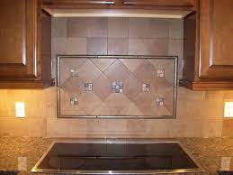 beautiful tile backsplash ideas for your kitchen midcityeast amusing design of the kitchen areas with brown wooden cabinets added with black electric stove and