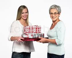 what to get an elderly woman for christmas an elderly woman and granchild exchanging christmas presents