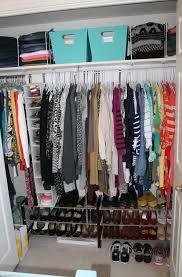 organizing a small closet with sliding doors home design ideas