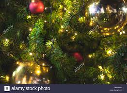 wire christmas tree with lights close up big yellow glitter ball christmas on tree with wire white
