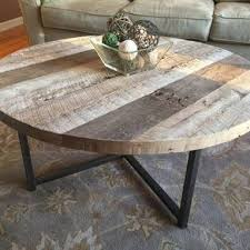 round wood coffee table rustic round reclaimed wood table with metal base by eric kucharczyk mkla