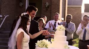 wedding cake cutting newlywed cutting their wedding cake