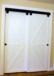 Sliding Horse Barn Doors by How To Make Bypass Closet Doors Into Sliding Faux Barn Doors