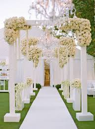 wedding arch entrance all white country club wedding with greenery