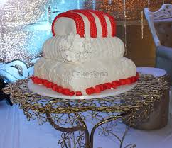 cake factory corals and pillows traditional wedding cake