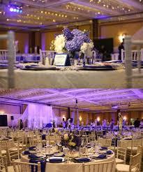 white gold and purple wedding san diego ethnic indian wedding planner centerpiece white blue