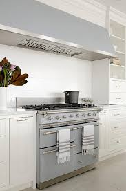 cuisine chagny a gray kitchen stands a shiplap backsplash and a