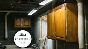 how to hang kitchen cabinets on brick wall hanging shop cabinets on cinder block
