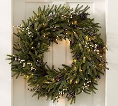 lit frozen pine wreaths pottery barn