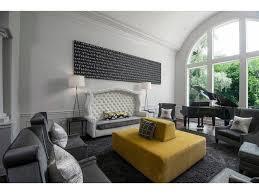 crown molding tufted custom sofa artwork tall ceilings piano art
