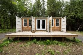 he built an off grid cabin out of shipping containers the