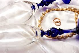 glass wedding rings wedding rings and chagne glasses stock photo picture and