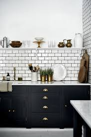 our suffolk kitchen painted in charcoal with brass handles