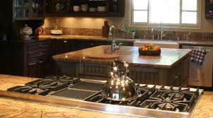 Under Cabinet Appliances Kitchen by Close Up On Range Top Island And Farm Sink