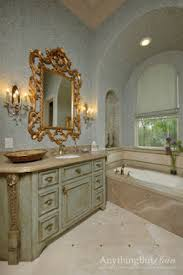 distressed furniture with gold highlights traditional bathroom