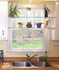 diy glass shelves in front of kitchen window plant shelves