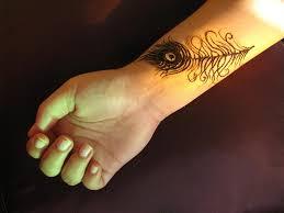 henna peacock feather tattoo on wrist