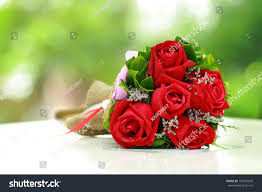 beautiful bouquet bright red flowers on stock photo 107569043