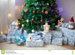 christmas tree with lots of presents under the tree lights and