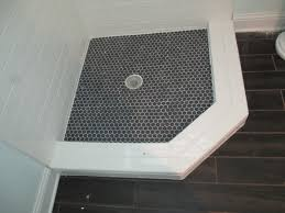 black and white hexagon tile floor and hex floor wood baseboards
