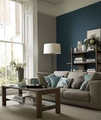 living room gray paint teal accent wall gray couch very