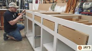 how to build inexpensive cabinets diy budget cabinets office remodel part 2