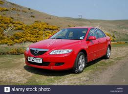 mazda saloon cars red mazda 6 saloon car parked at the side of the road in the stock
