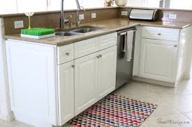 painted kitchen cabinets and tile backsplash u2014 a year later