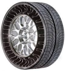 pneu sans chambre a air michelin et bridgestone déterrent la guéguerre des pneus sans air