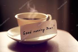 white ceramic cup of tea or coffee with nice letter u0027good morning