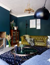 an eclectic living room final reveal dark green walls making