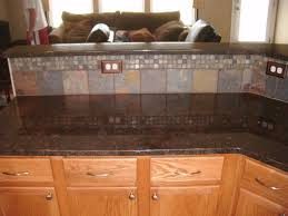 granite countertop kitchen cabinet paints brown tile backsplash