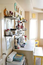 Craft Room Makeovers - craft room wall with whites and brights