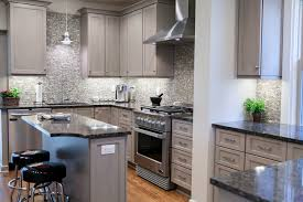 grey kitchen cabinets with granite countertops prep sink orange drum shape hanging pendant lighting glossy grey