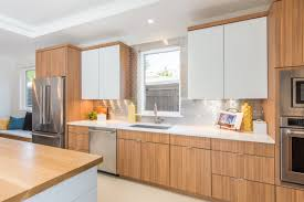 wood tone kitchen cabinets get the look two toned cabinets the kitchen company