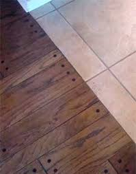 Tile Floor Installers Installing Hardwood Against Tile Transition Without Moldings
