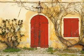 beautiful colorful old doorway with blinded door and window