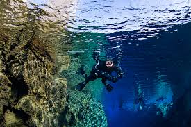 snorkeling images Silfra snorkeling day tour dive is snorkelling iceland jpg